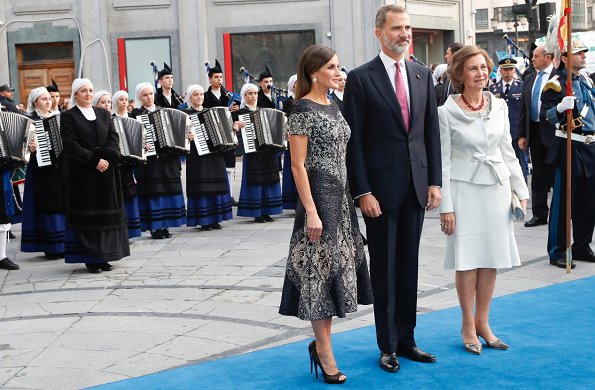 King Felipe and Queen Sofia at Princess of Asturias Awards 2018 ceremony. Queen Letizia wore Felipe Varela dress and Magrit pumps