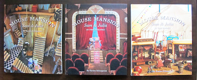 Three Mouse Mansion children's books on display on a table top.
