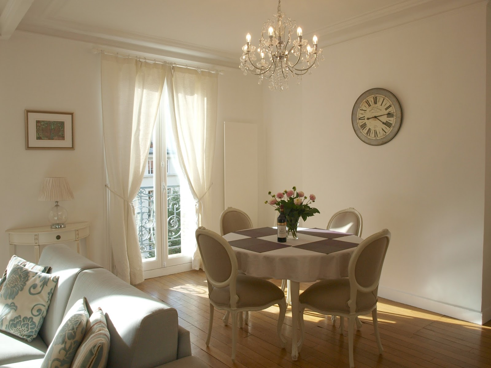 Paris apartment dining room with oval back chairs - Hello Lovely Studio