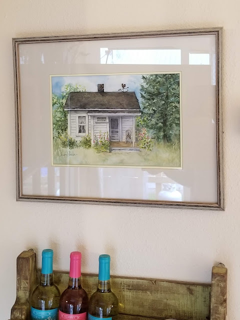 My painting of the little white house on Pat's property...with hollyhocks.  Artist Christy Sheeler