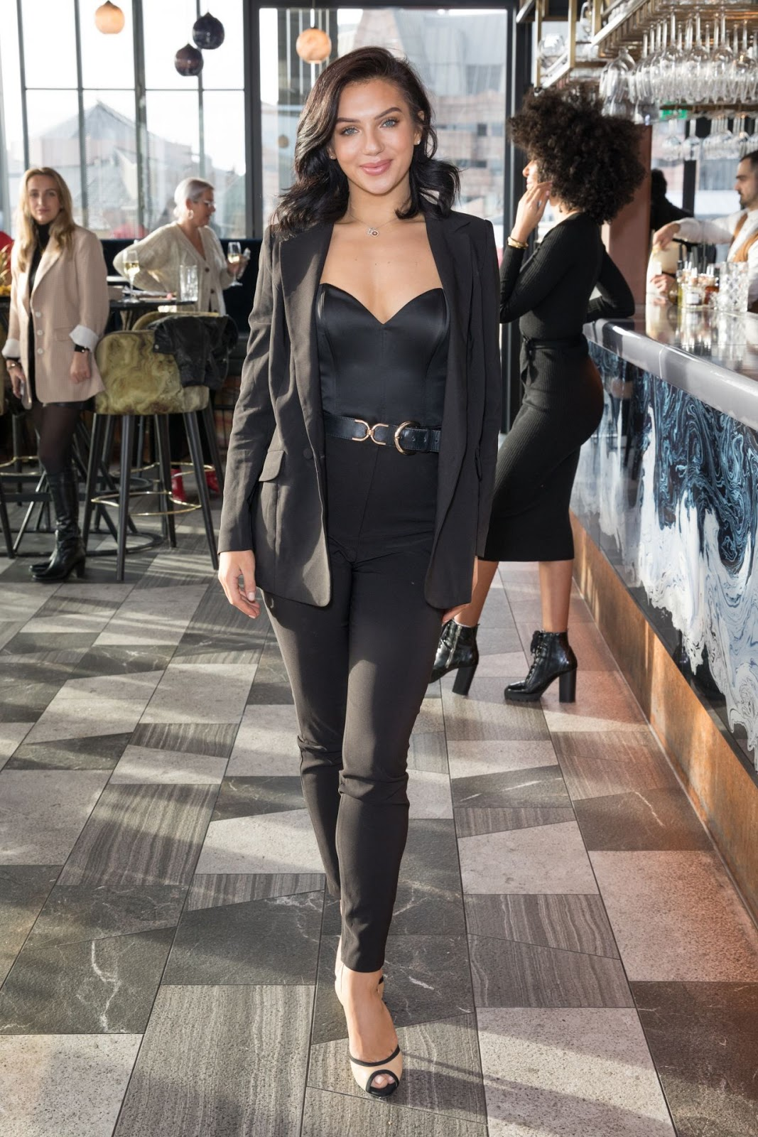 Alexandra Cane sizzles in black jumpsuit and blazer for private brunch in London