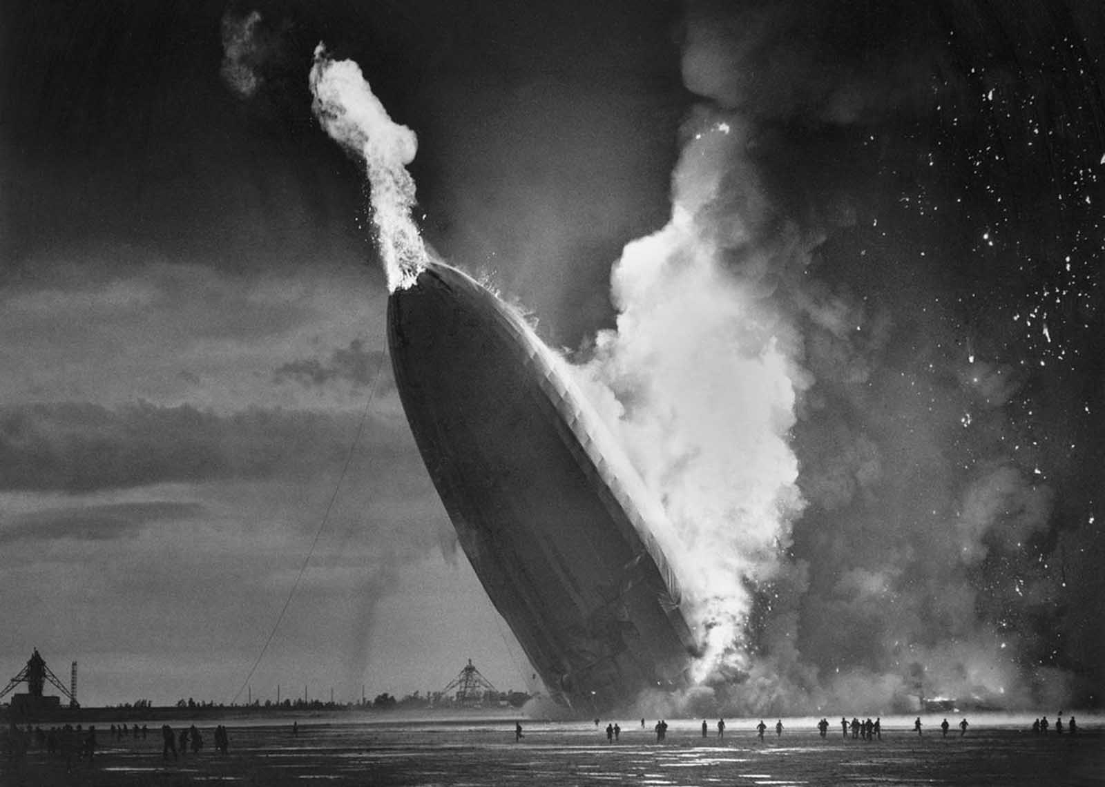 The German dirigible Hindenburg crashes to earth, tail first, in flaming ruins after exploding at the U.S. Naval Station in Lakehurst, New Jersey, on May 6, 1937. The disaster, which killed 36 people after a 60-hour transatlantic flight from Germany, ended regular passenger service by the lighter-than-air airships.