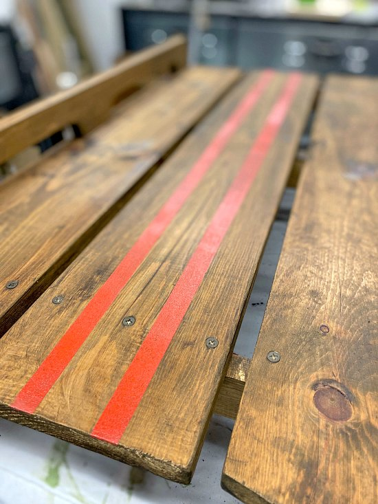 red painted lines on a wooden sled