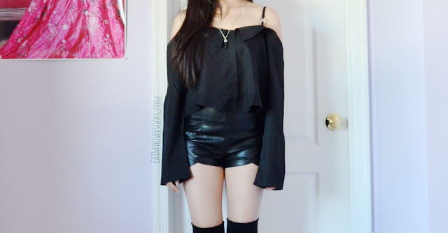 All black outfit featuring faux leather high waisted tulip shorts, over-the-knee suede wedge boots, and o-ring boat neck off shoulder bell sleeve black blouse from SheIn.