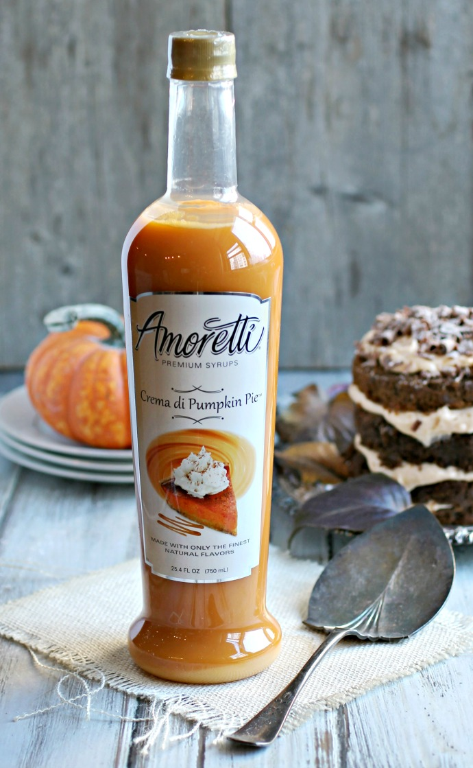Recipe for fudgy chocolate pumpkin cake with pumpkin cream cheese frosting.