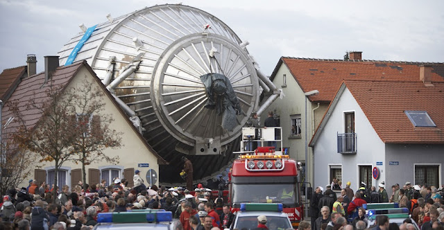 The spectrometer for the KATRIN experiment, as it works its way through the German town of Eggenstein-Leopoldshafen in 2006 on its way to the nearby Karlsruhe Institute of Technology.Karlsruhe Institute of Technology