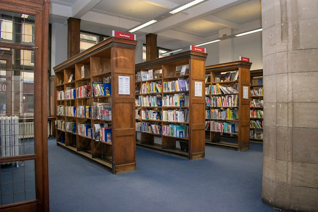 Original wooden shelving of books