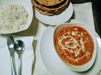 Serving paneer butter masala with jeera rice and roti for paneer butter masala recipe