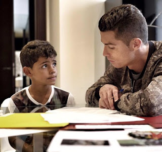 Daddy Cristiano Ronaldo helping out his child with his homework
