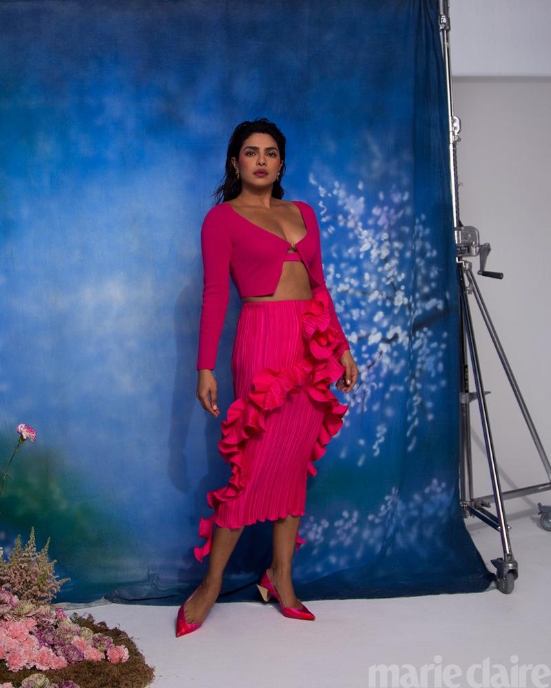 Priyanka Chopra poses in Versace look, Dolce & Gabbana earrings, and Christian Louboutin shoes.