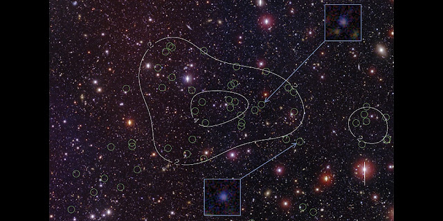 The newly discovered protocluster of galaxies located in the Bootes field of the NOAO Deep Wide-field Survey. Green circles identify the confirmed cluster members. Density contours (white lines) emphasize the concentration of member galaxies toward the center of the image. The patch of sky shown is roughly 20 arcminutes x 17 arcminutes in size. The cluster galaxies are typically very faint, about 10 million times fainter than the faintest stars visible to the naked eye on a dark night. The inset images highlight two example members that glow in the Ly-alpha line of atomic hydrogen. The protocluster is massive, with its core weighing as much as a quadrillion suns. The protocluster is likely to evolve, over 12 billion years, into a system much like the nearby Coma cluster of galaxies, shown in the image below. Credit: Dr. Rui Xue, Purdue University.