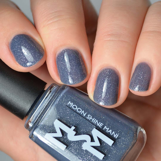 denim blue nail polish with silver glitter swatch
