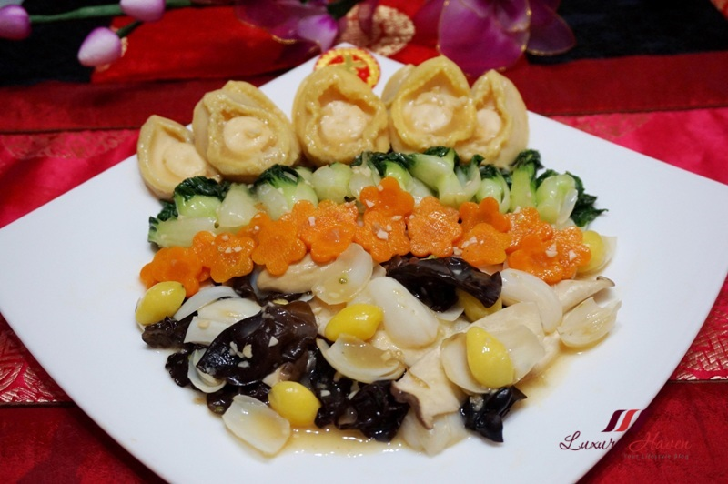 stir fried baby abalones with assorted vegetables