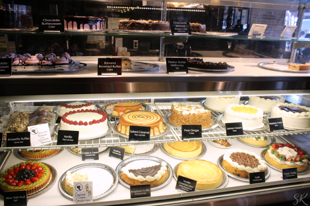 Cafe Latte cakes and treats in a case at bakery