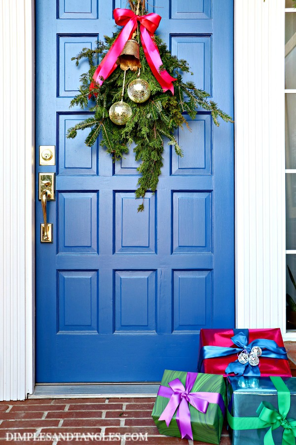 Dignity Blue front door, DIY cedar swag, fresh greenery, christmas porch decorations