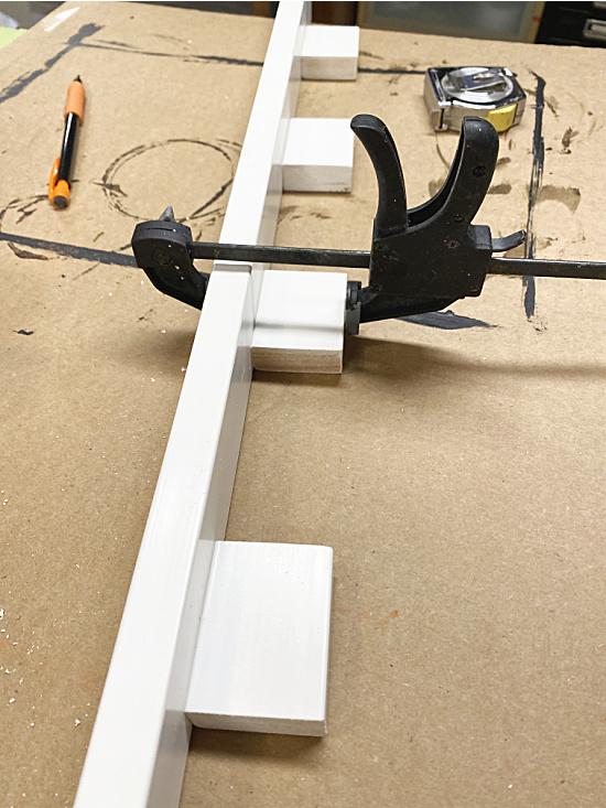 dentil shelf with a clamp