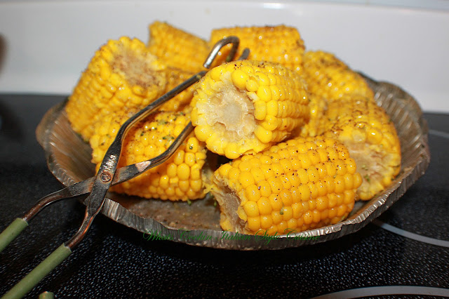 how to cook corn on the cob, this is boiled on an aluminum foil disposable pan with tongs for serving