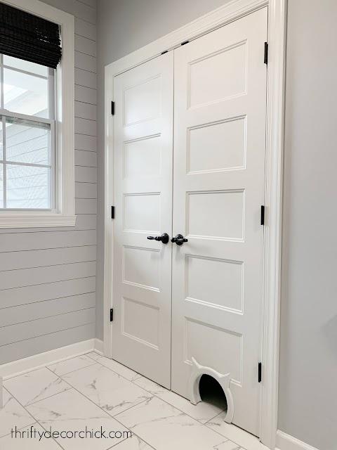Double white doors with cat door