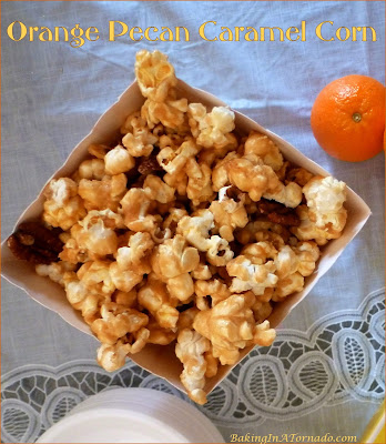 Orange Pecan Caramel Corn, a crunchy, sweet, citrus and totally addicting snack. | Recipe developed by www.BakingInATornado.com | #recipe #snack