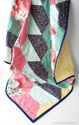 multi colored half hexi quilt.