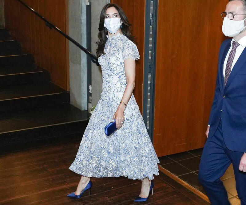 Crown Princess Mary wore a lace floral elodie dress from Moss & Spy, and  silk pumps from Gianvito Rossi. Prada satin clutch