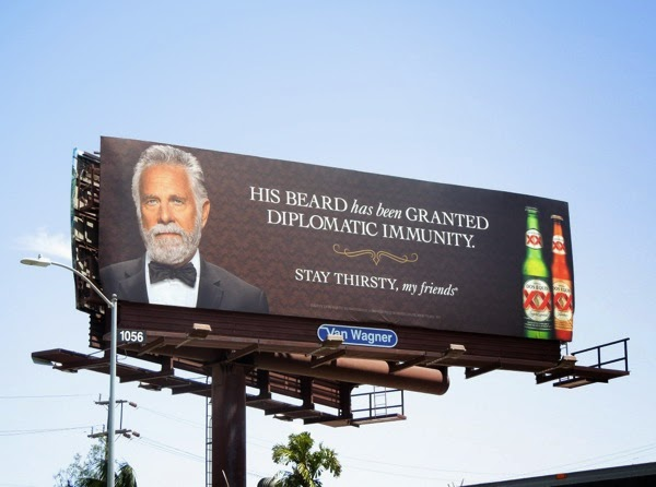 Dos Equis beard granted diplomatic immunity billboard