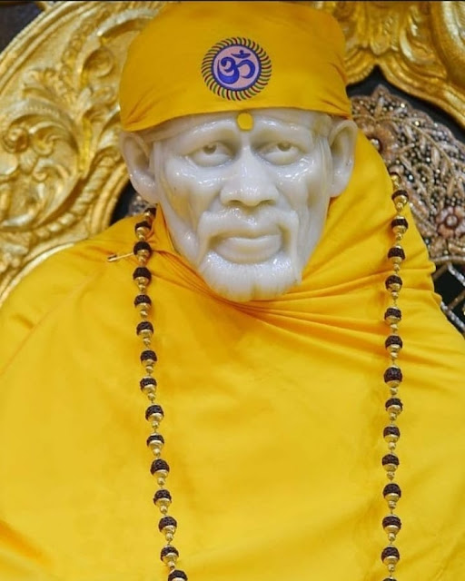 Yellow Color Clothes wear Sai baba in this images temple