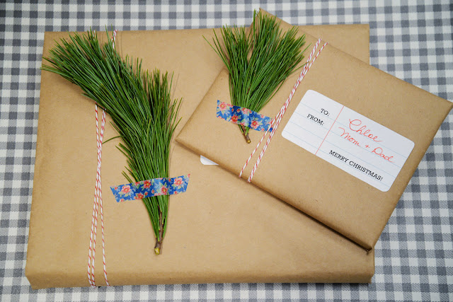 kraft paper package with baker's twine and greenery sprig washi tape | Ramblingrenovators.ca