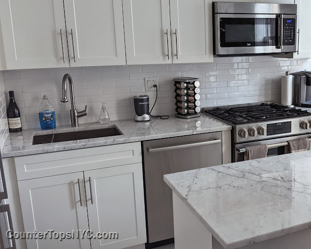 white kitchens with marble countertops