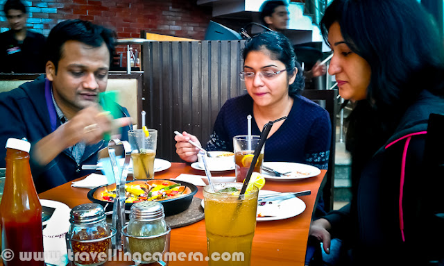With series of other Team outings in office, here is another quick lunch outing to neighboring Pizza-Hut and this time we were together to celebrate 5 successful years of Vaishali in our Team/Company. Let's check out this Photo Journey through my HTC Desire HD...Completing Five years in our company are very important as employee becomes eligible for taking 4 weeks sabbatical, and of course they get salary for this period :) ... This is one of the unmatchable gift from the company apart from other gifts they offer on completing 5/10/15 years...Although it's sort of unusual to spend continuous 5 years in one Software Company but our work-space is different in that sense. Many folks love to stay back due to unmatchable work-culture and kind of people you meet in the office. Most of the folks in our team have completed 5 years or about to complete, except few who have joined us directly from colleges. Now it's time for Vaishali to plan her sabbatical and I am sure that she will make best use of it.Vaishali had joined during Dec'2006 when team was very small, probably 8 folks in our team, which has reached to the count of 20+ now. During these 5 years, we had lot of fun apart from work. There was a time, when she used to teach us Salsa in office and approximately all team members joined her classes and learned various forms of dance apart from Salsa :) ... Apart from a Creative Photographer, Writer and Blogger, she is active in many of the CSR and social activities around Delhi... We wish her good luck and hope to see lot more successful things happening in future...Sourabh, Andaleeb and Anchita having some serious discussion on lunch table :) .. btw, there is rule of our Lunch Table and no one is supposed to talk about work related stuff. If someone does that, s/he needs to give party to everyone on that table. This special type of treat is called as - 'Munh-Bharai' !!!Drinks have arrived but still Saurabh and Ankur are waiting for something to eat...These were few photographs I could click on that day and missed Akshaya, Surender, Vaishali & Monif...Congrats Again Vaishali !!!