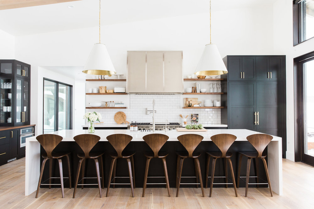 Beautiful kitchen with huge island bar stool in modern mountain urban minimal interior design room