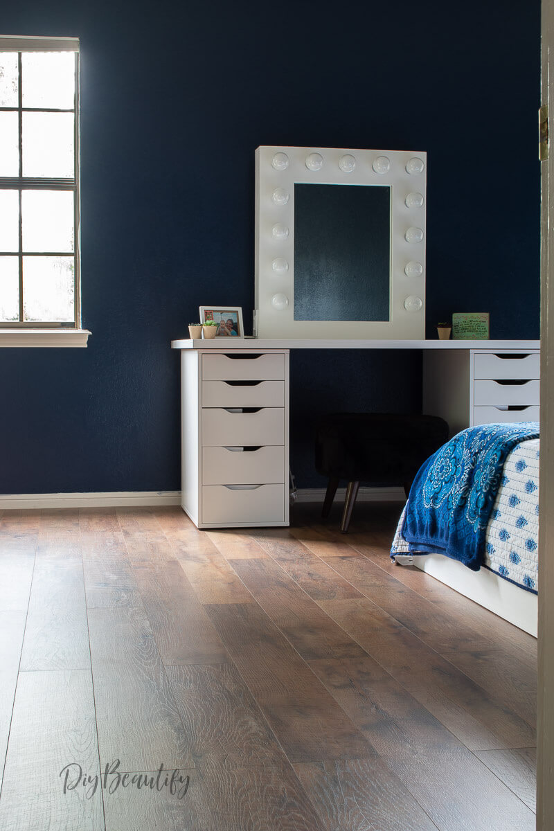 navy walls with Barnwood laminate floors