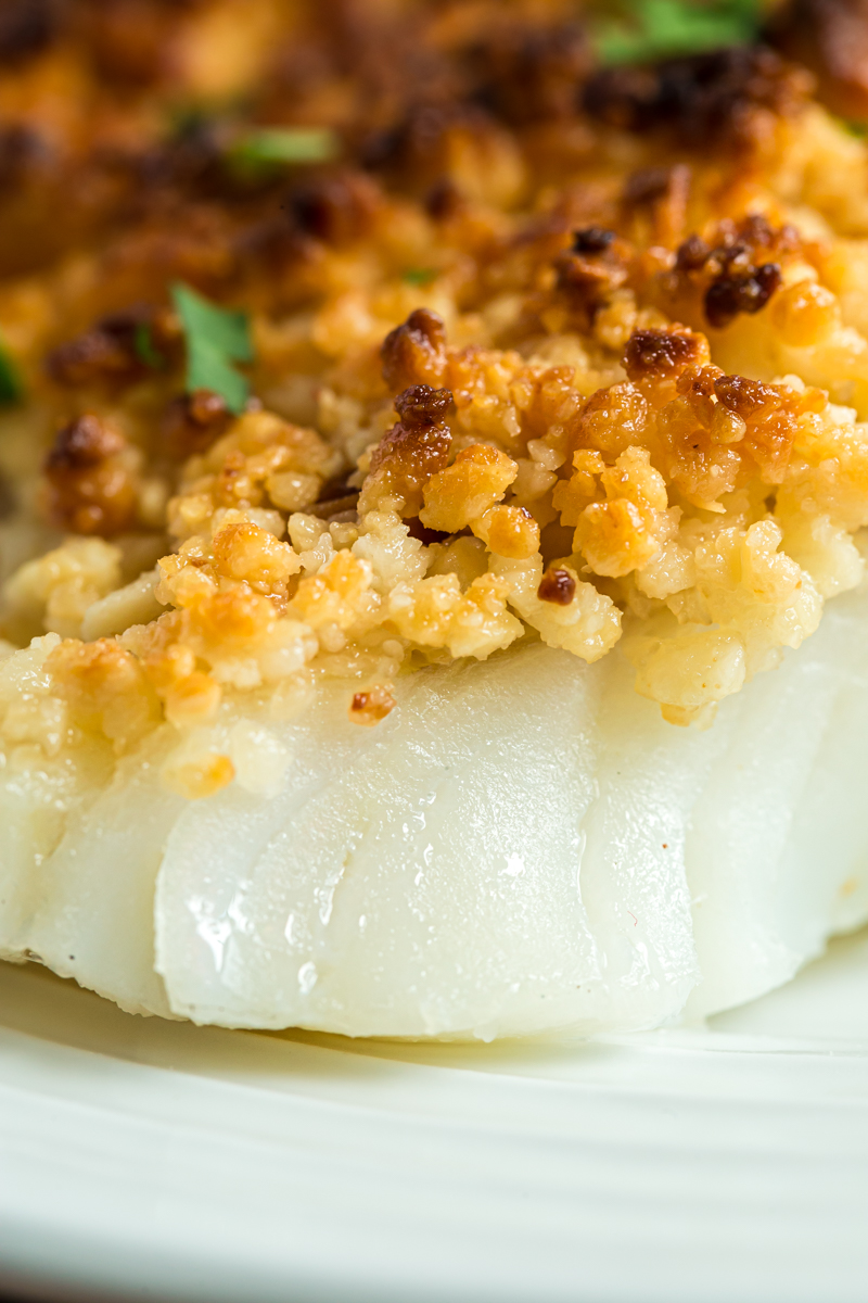 Oven Baked Coconut Macadamia Fish Fillets are a delicious fish recipe that is super simple, but fancy enough to impress company, and perfect for your low carb or keto lifestyle! The bonus is it can be made from start to finish in less than 30 minutes! #lowcarb #Keto #glutenfree #fish #cod #seafood #macadamia #coconut #sheetpan #easy #recipe   bobbiskozykitchen.com