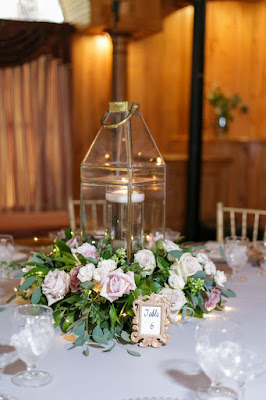 rustic table setting with lantern and lights