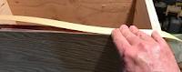 Putting veneer in place