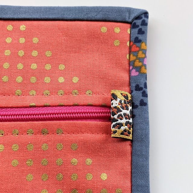 ribbon sewn in binding to conceal zipper end