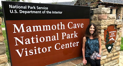 Nancy in front of visitor's center sign at Mammoth Cave Park