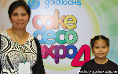 mother and daughter at cake expo