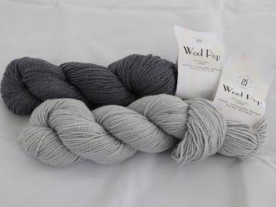 Blend of Bamboo, Superwash Wool, and Polymide in DK weight.
