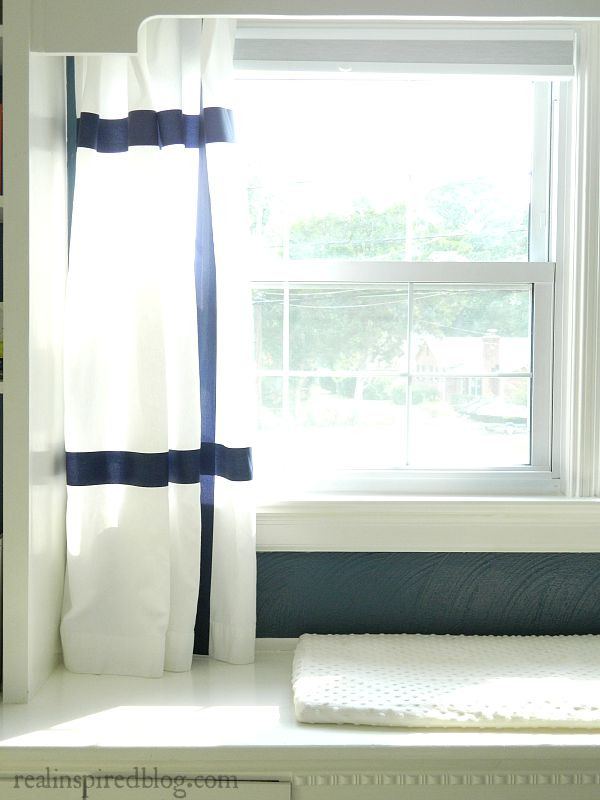 Such an easy way to make striped curtains without any sewing or painting! How to make knock-off Ikea Marmorblad curtains without sewing! hanging in window short curtains navy stripes white curtains diy no sew
