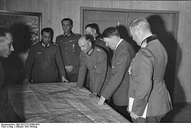 A typical Hitler map session at Fuhrer Headquarters worldwartwo.filminspector.com