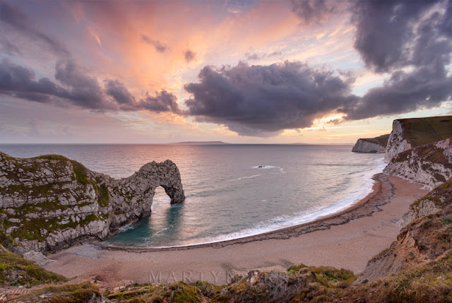 Beautiful colours over the rock arch of Durdle Door in Dorset