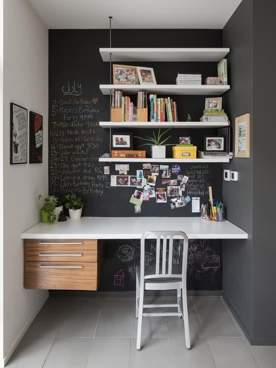 Home office with graffiti wall and blackboard in the background