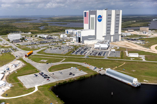 An aerial view of the SLS core stage booster for Artemis 1 being transported to the Vehicle Assembly Building at NASA's Kennedy Space Center in Florida...on April 29, 2021.
