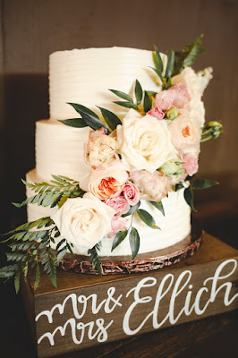 wedding cake on wooden stand