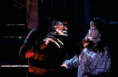 "Kim Myers and Robert Englund square off in a movie scene from ""A Nightmare on Elm Street 2: Freddy's Revenge"""