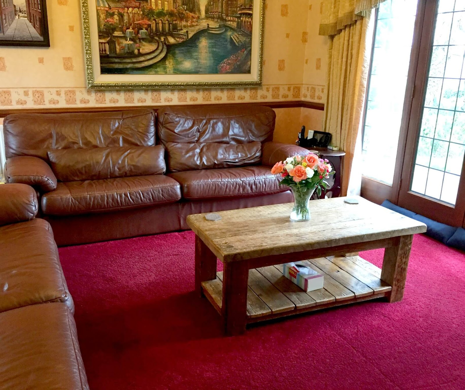 Brown leather sofa, in our lounge