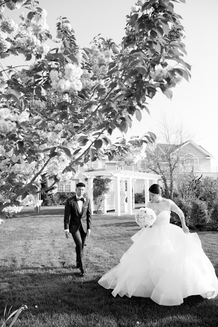 Walking on the grounds outside for portraits at Jin and Christopher's Bridgeview Yacht Club Wedding