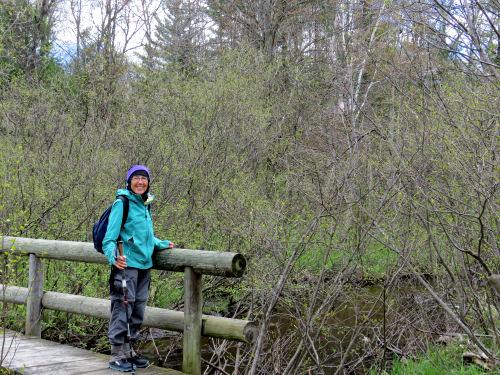 hiker on a bridge