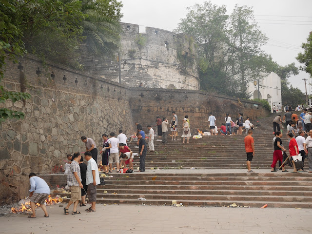 people making offerings for the Hungry Ghost Festival near Xijin gate in Ganzhou